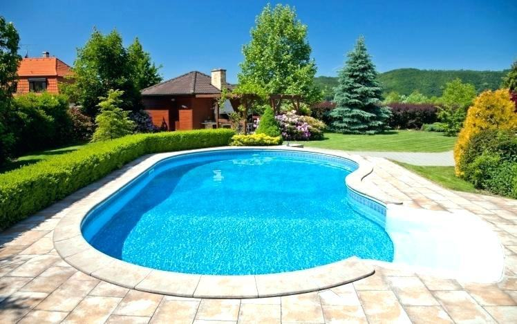 Above ground pool with partial deck and sidewalk
