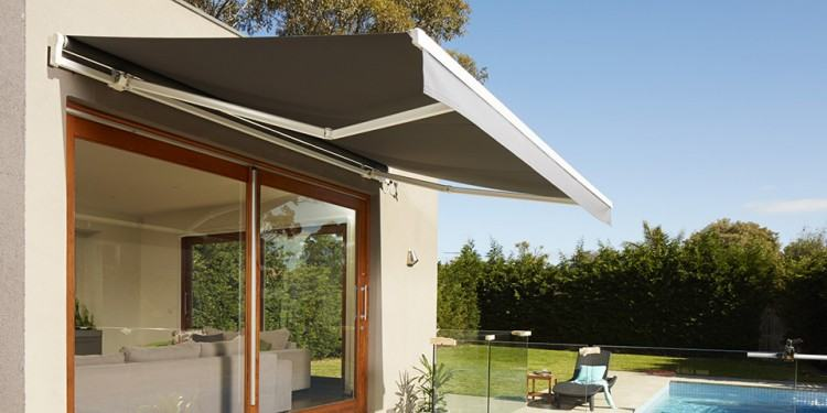 Architect Tim Angus designed horizontal aluminium sun shades with fixed  angled blades for the north and west windows in this Melbourne renovation