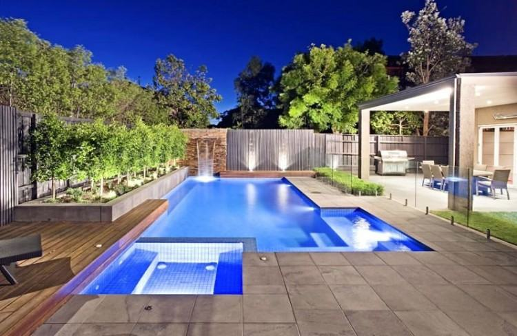 A good pool landscaping design will make your pool the focal attraction and  bring out so much more in your yard