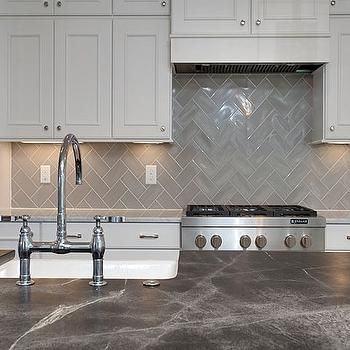 Small modern kitchen with custom copper backsplash that also adds  pattern [From: Regina Bilotta