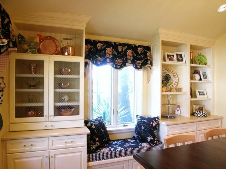 Remodeled kitchen with white cabinets by Neal's Design Remodel