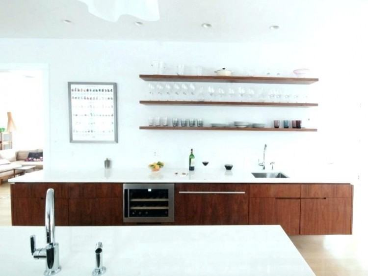White cabinets, black countertops, and  a farmhouse sink