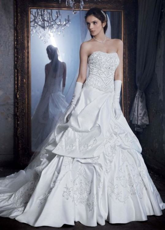 Bride wearing one shoulder plus size wedding dress with another bride in  background