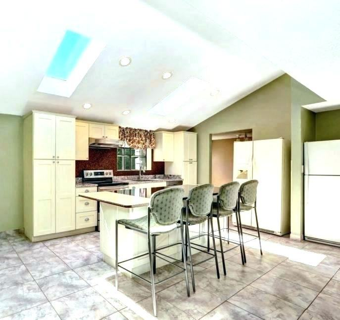 Kitchen with vaulted ceiling seems like the perfect place for  skylights! [From: David