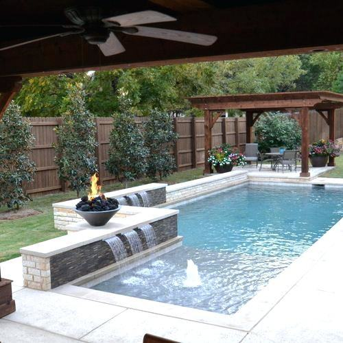 tanning ledge on one end of rectangle pool