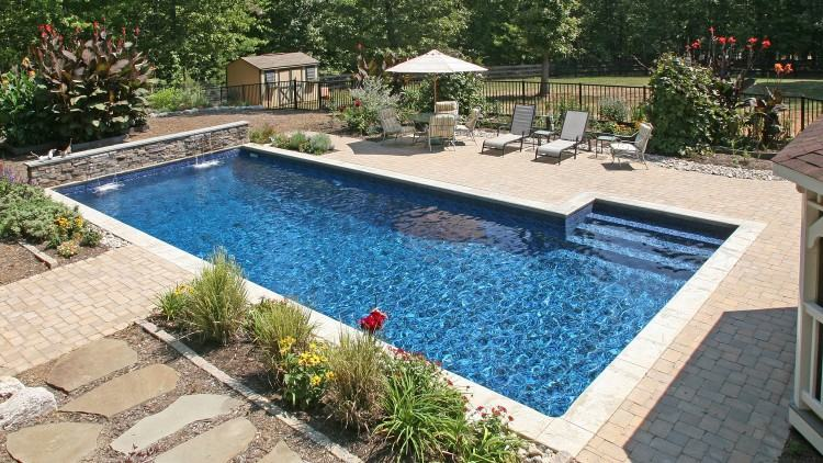Custom design and construction of luxury inground swimming pools, spas, and  water features