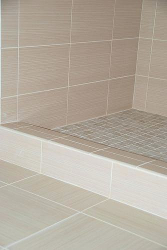 frosted sage green glass subway tiles in shower built linen closet tile  bathroom with white