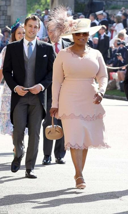 Serena Williams made an entrance with her husband to the wedding wearing a  light pink Versace draped dress and a headpiece arrangement