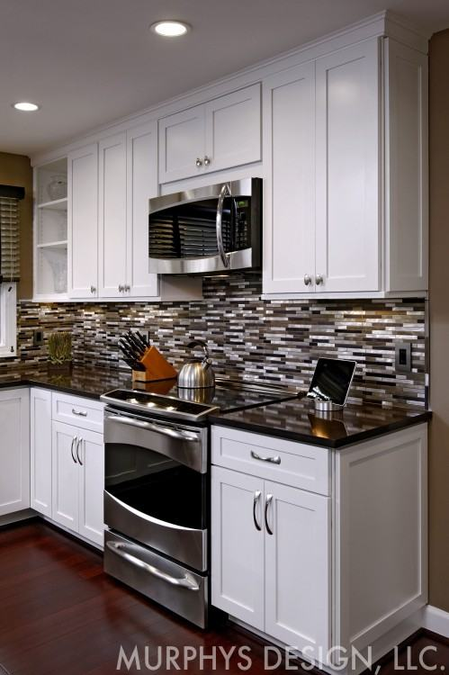 remodeled kitchen in yorktown virginia with custom cabinets, kitchen  island, tiled backsplash,