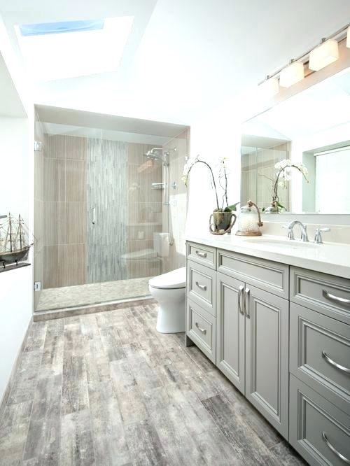 The tiles on the walls and floors of this bathroom have an almost wood  grain look to the them, giving the space a warm vibe