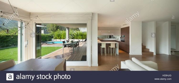 Large panoramic windows overlooking the garden with a terrace
