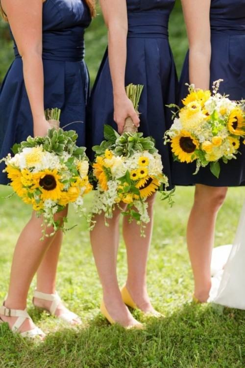 wedding bouquet tan bridesmaids dresses with sunflowers