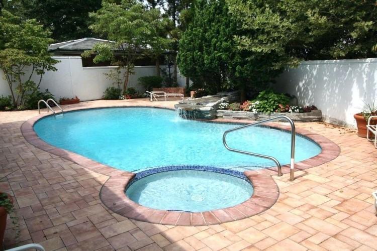 incredible natural stone waterfall inground pool and spa design and  installation mahwah nj