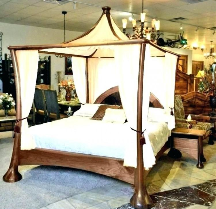A finely carved mahogany and 'limestone' painted four poster King Size Rice  Bed, the serpentine arched and moulded edge headboard flanked by acanthus  leaf