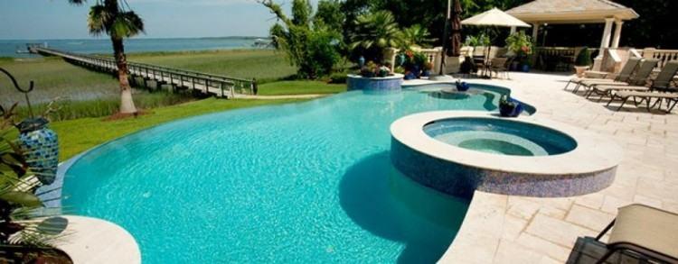 Custom outdoor zero infinity edge swimming pool designs with waterfalls  and fiber optic lighting NJ Custom perimeter overflow spa