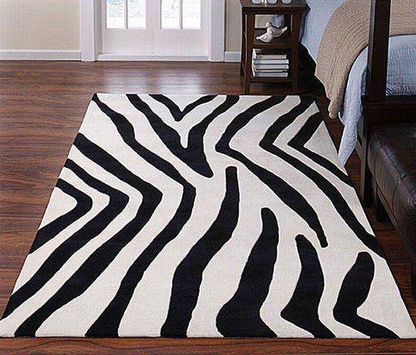 Rug under bed · Warm, neutral colors provide cozy ambience without taking  away from the intimacy
