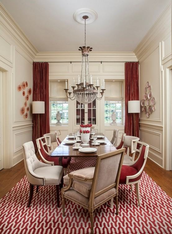 A red centerpiece adds lively energy to a glass dining table