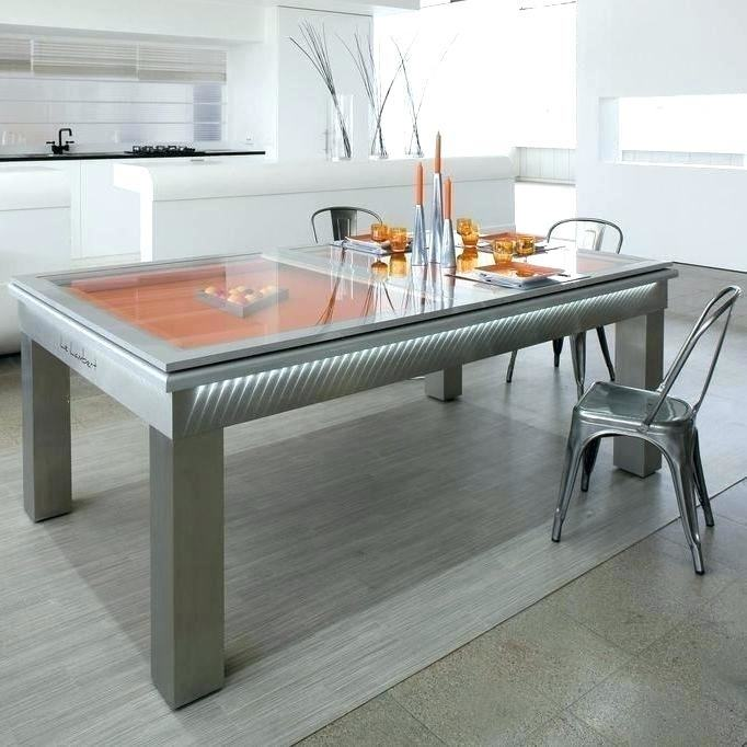 The Fusion Pool Table by Aramith is a clean, modern dining room table that  doubles as a pool table