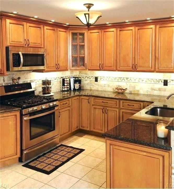 Floor Tiles Kitchen Ideas for Elegant Maple Cognac Wood Kitchen Cabinets  With Wood Looking Tile Flooring