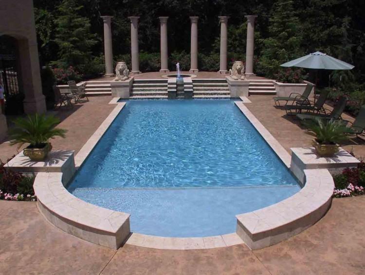 Simple rectangular fiberglass pool with sheer descents