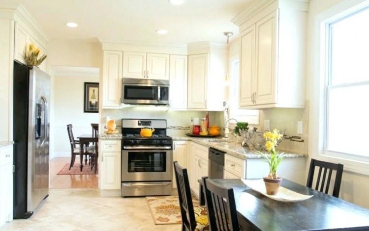 Ivory kitchen cabinets with Mocha Glaze from Homecrest Cabinetry against  light oak hardwood floors