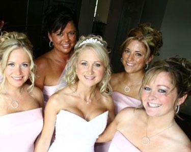 her wedding at Hedsor House, as did her gorgeous bridesmaids! Her  elegant, down 'do worked perfectly with her strapless gown and the braided  up styles