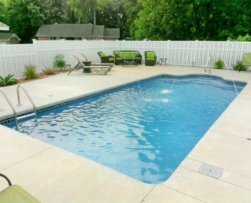 Minimal white background swimming pool design
