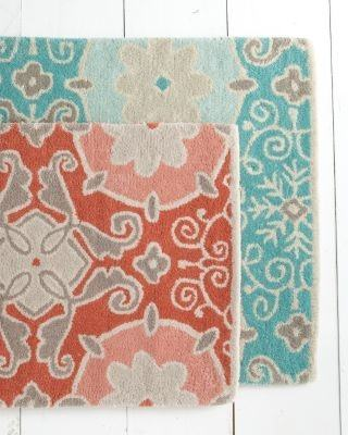 Area rugs are a great way to bring warmth and texture into your home