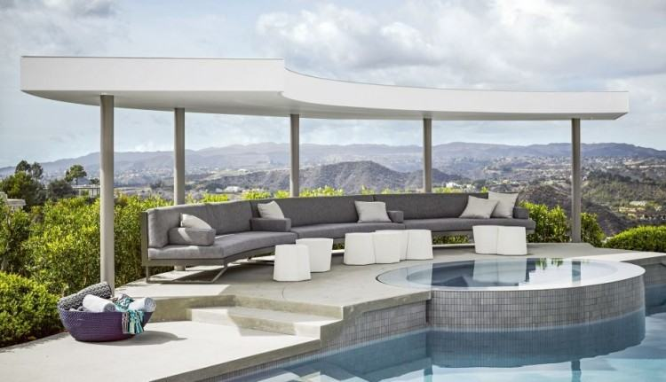 Architects are bringing the outside in by creating permanent, covered living  spaces with all the same amenities as an indoor family room, living room,