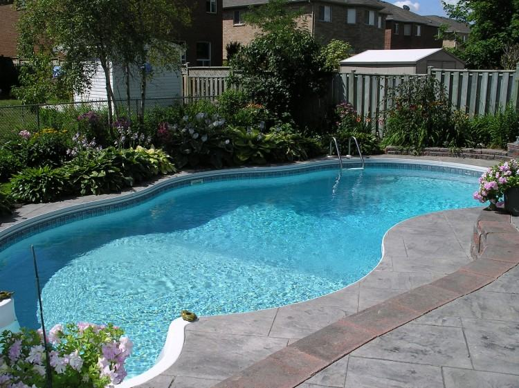 Luxury in ground swimming pool with waterfalls and fire pit design and  installation Mahwah NJ