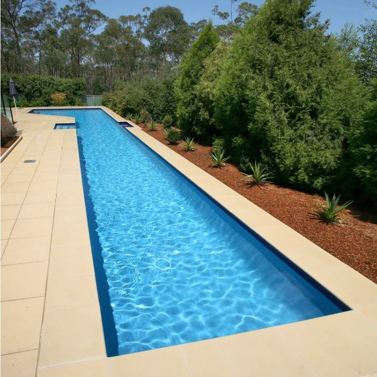 A custom made water feature with planters and wall behind  hide the