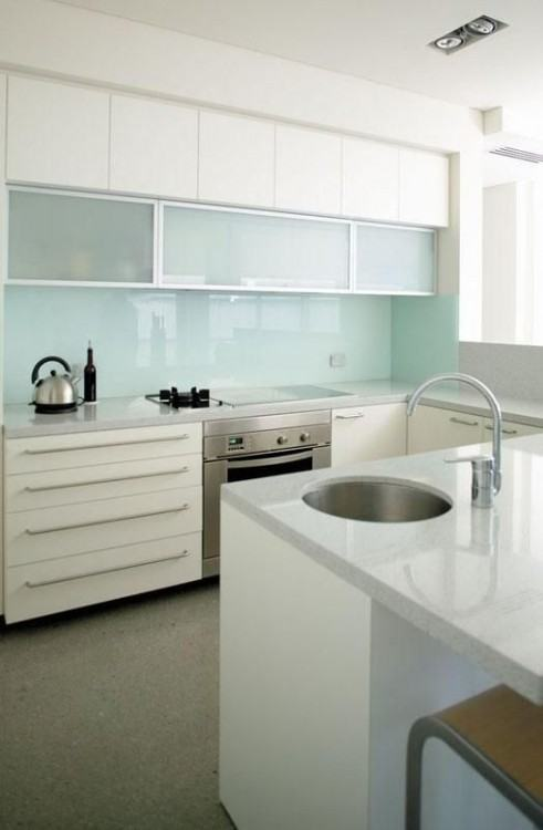 Stainless hood with taupe cabinets