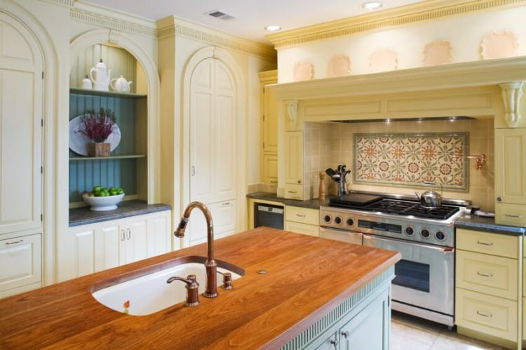 Clean white cabinets, classic Soapstone tops, and a gleaming subway tile  backsplash