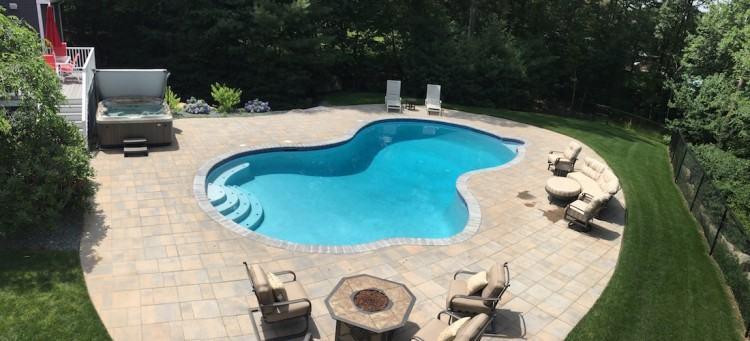 Custom outdoor zero infinity edge swimming pool designs with waterfalls  and fiber optic lighting NJ