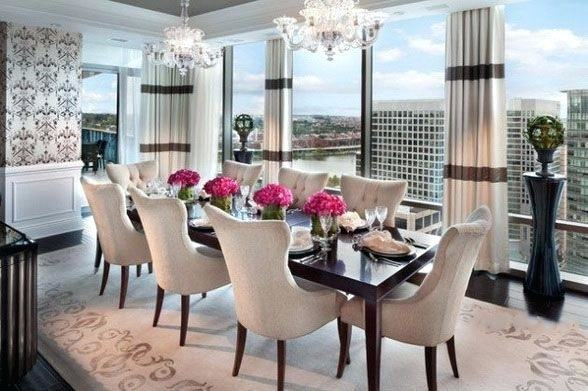 A delicate crystal chandelier lights the table  and the