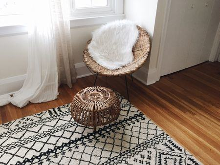 White lacquer campaign desk, geometric print rug