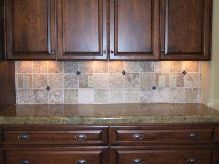 Kitchen with backsplash featuring tile shapes influenced by global trends