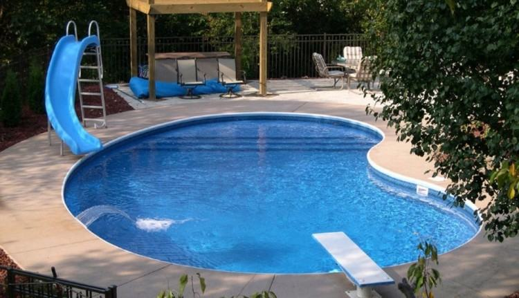 On the positive side of a yard sloping away you have a few more options of  thing you can do to make for a more dramatic pool