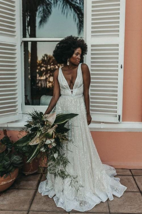 We love Make Up by Charelle's approach to  beauty for this styled shoot: stunningly natural hair, lush lashes, bold  lips and a